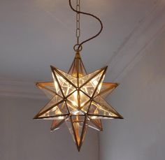 Moravian star lantern fitted with vintage style lamp for warm light.