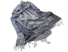 "Add an element of style as well as comfort to your wardrobe with this lovely Celtic pashmina. This beautiful scarf features a detailed Celtic weave border on the outside, as well as fringe for a little extra flair! The pashmina is crafted from 50% pure new wool and 50% silk giving it a soft touch and a warm feel. Dry clean only! The scarf measures approximately 23"" wide and 70"" long with 2"" of fringe at each end."