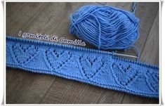 Occorrente per realizzare la copertina a maglia con cuori traforati: 400 gr. di lana da lavorare con un paio di ferri numero 3,50.