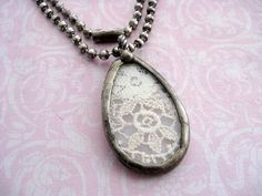 Vintage Lace Necklace Soldere Lace Pendant by Jeweliansun on Etsy, $19.00  This would also be a cute idea with lace from your mother's wedding dress (if she had lace)