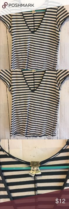 """We the Free Free People Striped V-Neck Tee This striped tee is essential to any closet! It is a size small and measures 24"""" long and 17"""" from armpit to armpit when it is laid flat. It is 100% Cotton. If you need additional measurements please let me know and I will get them to you quickly before purchasing. Free People Tops Tees - Short Sleeve"""