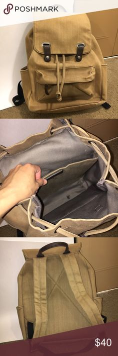 """Everlane snap backpack Everlane snap backpack in apricot (from 2015)! In good used condition; there is a stain on the inside at the bottom (shown in the second picture) (but it's not visible on the outside!!), and the bottom of the back has some pigmentation from jeans. Dimensions are 16"""" h x 13"""" w x 5"""" d. Has a padded sleeve for laptop, fits both 13"""" and 15"""" laptop sizes. Everlane Bags Backpacks"""