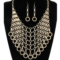 A bib design statement necklace draped with multiple layers of dangling linked chains. Comes with matching fishook earrings.    Features: ●Color: Gold ●Drop: 4 1/2 in. ●Metals: Gold Plated ●Size: 18 in. (L) + 2 1/2 in. Extension  ●Imported   **Not intended for children under 12 years of ...