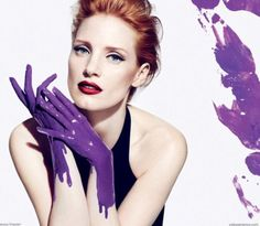 Jessica Chastain wows in the latest Yves Saint Laurent ad campaign for Manifesto with purple 'gloves' that match the new fragrance's bottle color.