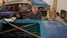 Chipping away at the underseal.  Left to right: Garry Orton, Russ Pinker, Andrea Wallace.  Image: Mike Wilson