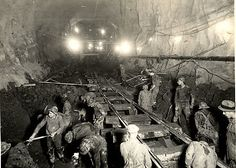Mid Hudson (Lincoln) Tunnel Construction: North Tube, Workers Clearing Bottom of Rock Tunnel at Weehawken, New Jersey, After Completion of Excavation] Unknown Artist, American 1937