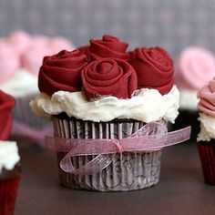 cupcakes instead of cake! only change = vanilla, not chocolate and red ribbon instead of pink