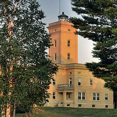 Sand Hills Lighthouse, Ahmeek, Michigan. This grand yellow-brick castle of a lighthouse was built in 1917 to house three lightkeepers and their families.