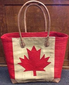 Flag Wicker Bags | The Real Wool Shop Wool Shop, Canada Images, Round Design, Straw Bag, Wicker, Artisan, Reusable Tote Bags, Flag, Craftsman