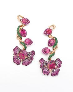 Wendy Yue's earrings in gold are a colourful concoction, featuring rubellites, white sapphires, pink sapphires and tsavourites.