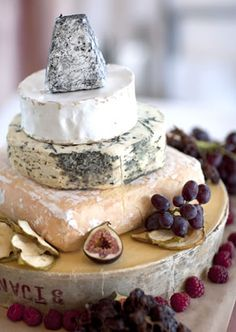 Cheese wedding cake, different shapes, assorted fruits, dried apple slices.