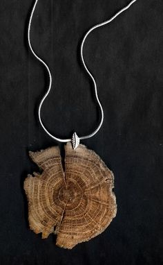 a necklace made from a 100 year old cedar post section...