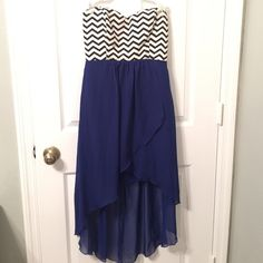 Chevron and Blue Dress Beautiful dress with royal blue on the bottom and black and white chevron on the top. Support in the chest area. Looks good with gold jewelry. Can fit M. Dresses