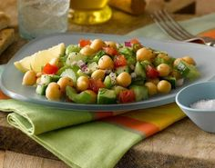 A healthy and high-fiber mixed vegetable salad with chickpeas, cucumbers, tomatoes and celery - lots of crunchy goodness in there! Vegetarian, vegan and gluten-free.