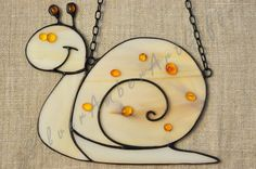Stained glass snail - funny animal decorated with natural Baltic amber