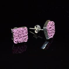 Leuke zilveren oorstekers met lila details