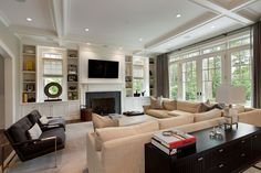 built ins around fireplace Living Room Traditional with dark gray armchairs ceiling beams