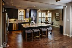 Regency Homebuilders : Open Concept Living, Open Kitchen, Pendant Lighting, Recessed Lighting, Scraped Hardwood, Dark Cabinets, Staggered Cabinets, Flush Top Island, Squared Openings, Modern Style (Grays Hollow - Lynwood Plan)