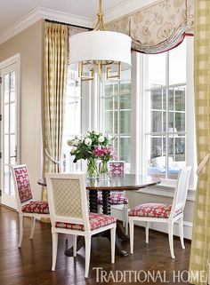 Cheery pink and green fabrics brighten the dining spot near the kitchen with views to the porch.  - Photo: Emily Jenkins Followill / Deisgn: Carolyn Kendall with Betsy Trabue