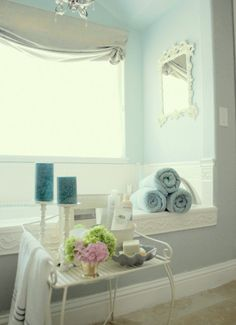 love the blue color but also think that little table next to tub is great idea
