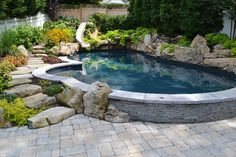 """Swimming pool Pulled up"""" out of the patio to create a seatwall so friends can sit right at the waters edge."""