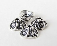 these are gorgeous antiqued fine silver plated lily flower bead caps by tierracast sold in