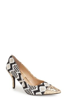 A glittery heel and cap toe extend the modern glamour of this mixed-media pump that's destined to steal the scene.