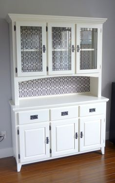 Such a cute hutch makeover.  Step by step directions including how to cover the back in fabric.  Andrea + Kris + Our Chaos: Hutch: Completed!!!