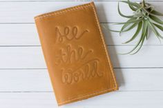 This handmade leather passport cover is perfect for your next getaway! The Earhart is named after the famous pilot and perfect for the minimalist traveler. Made from quality, soft, top grain leather that will protect your passport and give it a new and unique look! Each piece of leather shows usual wear that gives each case its own character. Cover is embossed with a see the world design with options of adding your initials or name. Fits all passports and has two folds on the inside to…