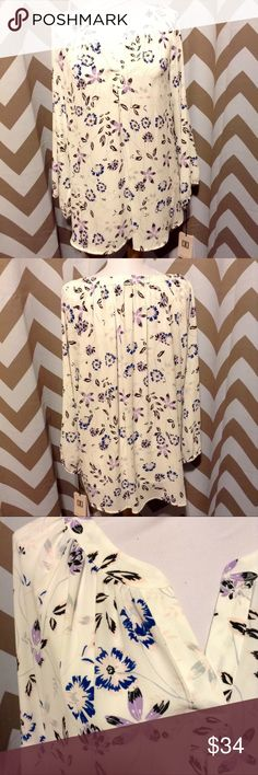 ➕ XL NWT Ivanka Trump Floral Career Top This charming floral top is perfect all year round.  Works well under a blazer or cardi or wear it solo.  Cream background with blue and purple floral pattern.  Longer length.  100% polyester.  Very lightweight.  V-neck with 3/4 sleeves.  Been hanging in non-smoking pet free closet. Ivanka Trump Tops Blouses