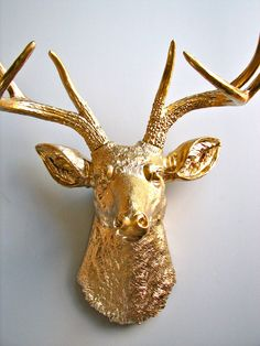 Over the fireplace?  Faux Taxidermy Deer Head wall mount in GOLD. $109.00, via Etsy.