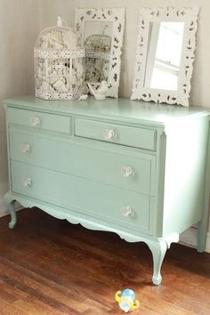 mint dresser and decorations are so pretty. Had to chuckle at the sippy cup on the floor -- that's reality!