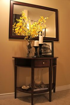 A mirror/ console table is a welcome addition at the bottom of the stairway. The mirror makes the space feel larger instead of feeling like a dead end. It also brightens the space by reflecting light. Room Decor, Console Decoration, Decor, Small Console Tables, Home, Entryway Decor, Foyer Table Decor, Home Decor, Table Decorations