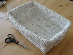 """Plarn Basket -  from CraftStylish. A rectangle basket made out of plastic shopping bags! (These are usually round.) To make a rectangle, this person crocheted a cross-shaped piece, then sewed the corners & edges together using more """"plarn."""""""