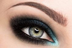 Dark black and a tint of green eye makeup