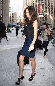 Navy pencil skirt + Sheer black blouse + Stunning heels + Sexy hair
