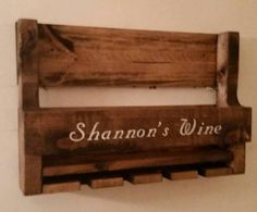 Rustic Pallet Wine Rack. This Wine Rack is Approx 14 1/2 tall x 22 wide x 5 deep. It will hold 6 Standard size bottles of Wine and has space for 4 Wine Glasses in the holder mounted in the bottom of the rack. Please select your choice of finish. The rack comes with two pre-drilled holes