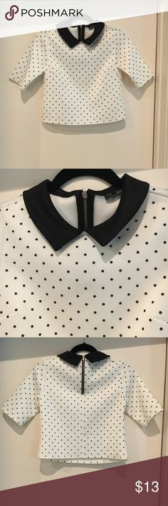 Zara Polka Dot Top This Zara top is just the cutest! It was rarely worn and has no flaws! It's zipper is still intact and it has no stains. It is more of a cropped fit but would look gorgeous with high waisted jeans or a skirt! Zara Tops Blouses
