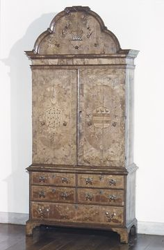 Cabinet Date: late 17th century Culture: British Medium: Oak, walnut and various other woods Dimensions: 107-1/4 x 50 x 22 in. (272.4 x 127.0 x 55.9 cm) Classification: Woodwork