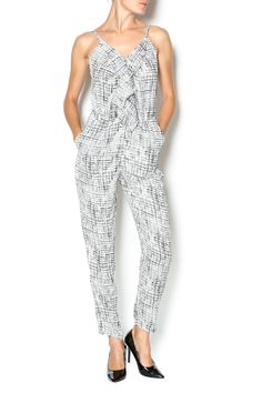Black and White. V-neck jumpsuit with a printed pattern and thin shoulder straps. Elasticized seam at waist, side pockets, and a side zipper. Will look good with flats. White And Black Jumpsuit by Under Skies. Clothing - Jumpsuits & Rompers - Jumpsuits Palo Alto, California