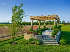 Viewing stand with pergola overlooks both the outdoor arena and Grand Prix field with two water jumps and a bank jump. Water Mill, NY farm