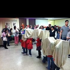 Great idea for a classroom teacher: make a dragon dance costume out of old boxes,sticks,and a long piece of cloth to teach your students about Chinese new year!
