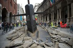 On October 1st a huge submarine burst out of the street in central Milan as part of a clever ad campaign orchestrated by M&C Saatchi Milano.   See more on Colossal:  http://www.thisiscolossal.com/2013/10/a-huge-submarine-bursts-through-the-streets-of-milan