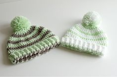 Super cute striped toboggan with a pompom on top and a ribbed edge! This would look cute used as prop for newborn photography or as a winter