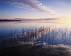 LAKE AND CLOUDS IN MORNING LIGHT, SWEDEN