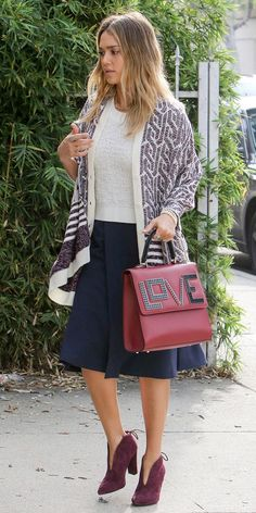 Jessica Alba in a printed cardigan, midi skirt, embellished top-handle purse and statement ankle boots