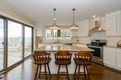 Total new renovation being completed. Panoramic spectacular waterfront view. Gardens galore. Perfect retreat. Private community beach & your own waterfront beach.