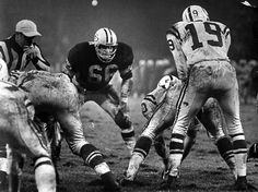 1962+green+bay+packers | Ray Nitschke of the Green Bay Packers stares at Johnny Unitas of the ...