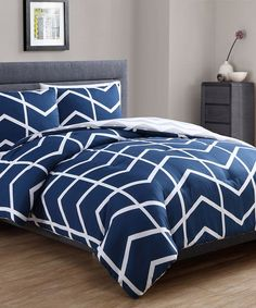 Enliven your bedroom décor with this comforter set showcasing a chevron design.