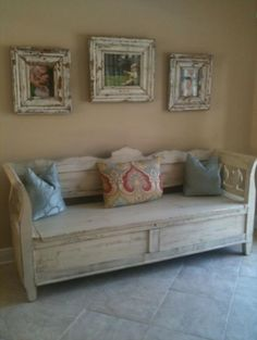 Antique storage bench with antique picture frames